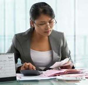 woman-with-receipts-etc---Accounts-&-Bookkeeping